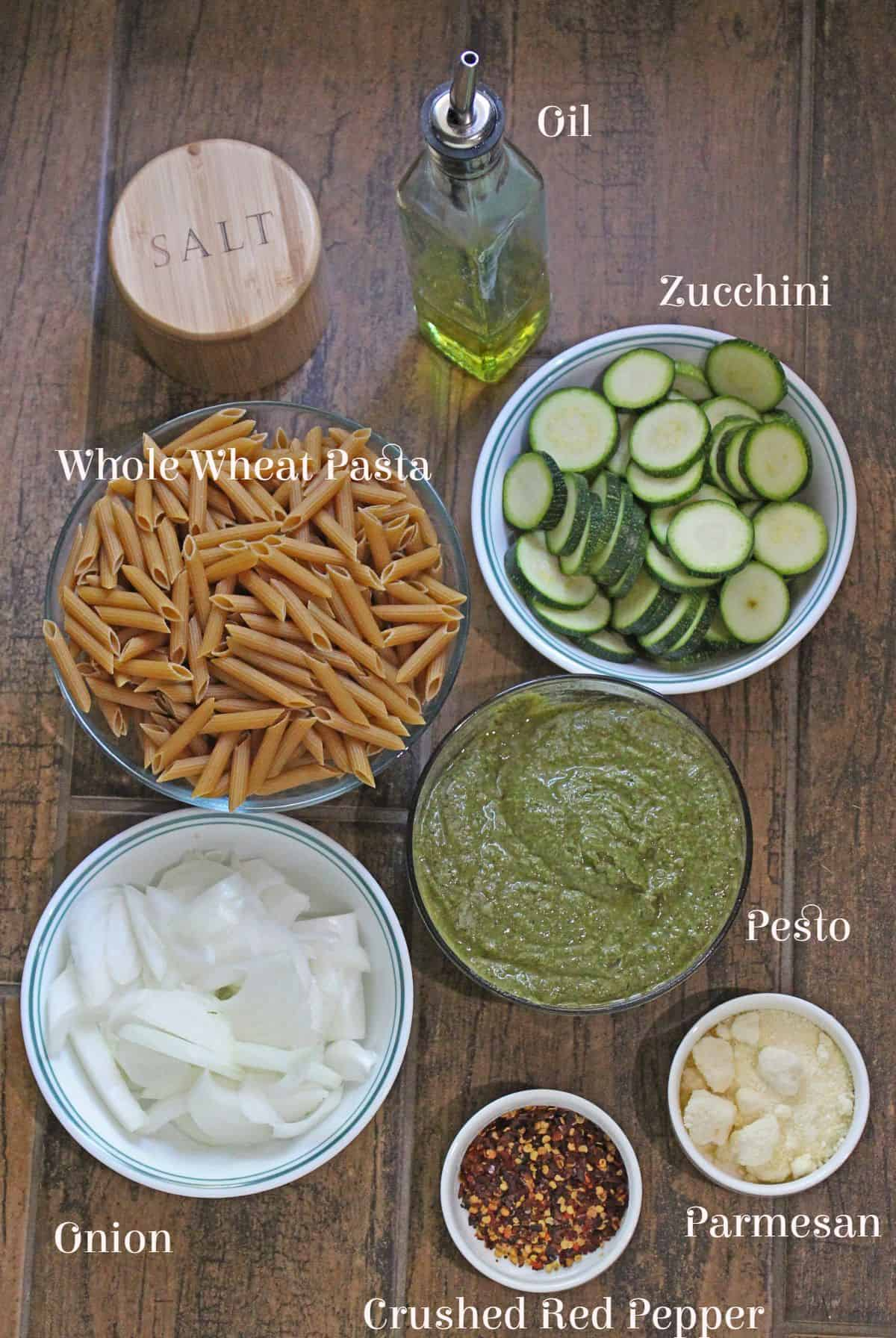 Ingredients laid out and labelled for zucchini pesto pasta