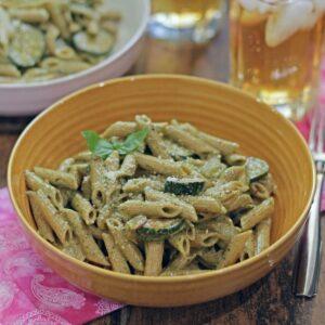 Zucchini pesto pasta in a yellow bowl