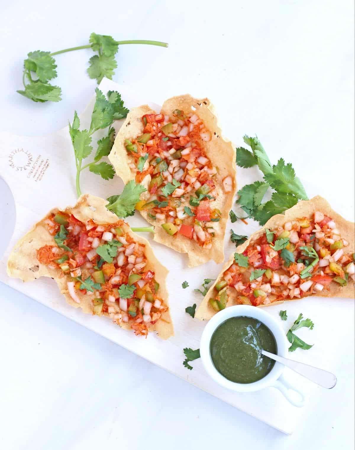 masala papad appetizer with cilantro and green chutney